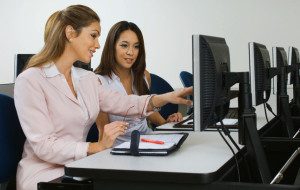 Businesswomen Working Together in Computer Lab